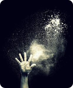 Hand and flour on black background